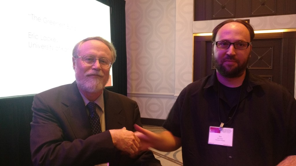 "Erick Lackey, graduate student at the University of Kansas, receives the Graduate Paper Award for Creative Writing from Robert Galin, a judge for the award, for his work, ""The Greenest Burial."""