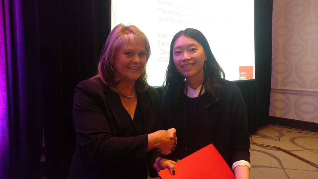 "Namhee Lee, graduate student from Syracuse University, receives a Heldrich-Dvorak Travel Fellowship from Lynnea Chapman King, Executive Director of SWPACA, for her project, ""Desire for Control: Mothers' Self-Control for Childcare."""